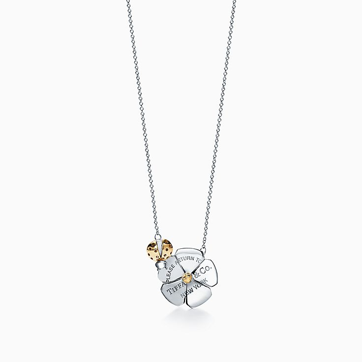 Return to Tiffany™ Love Bugs 系列:纯银和 18K 黄金瓢虫花朵项链
